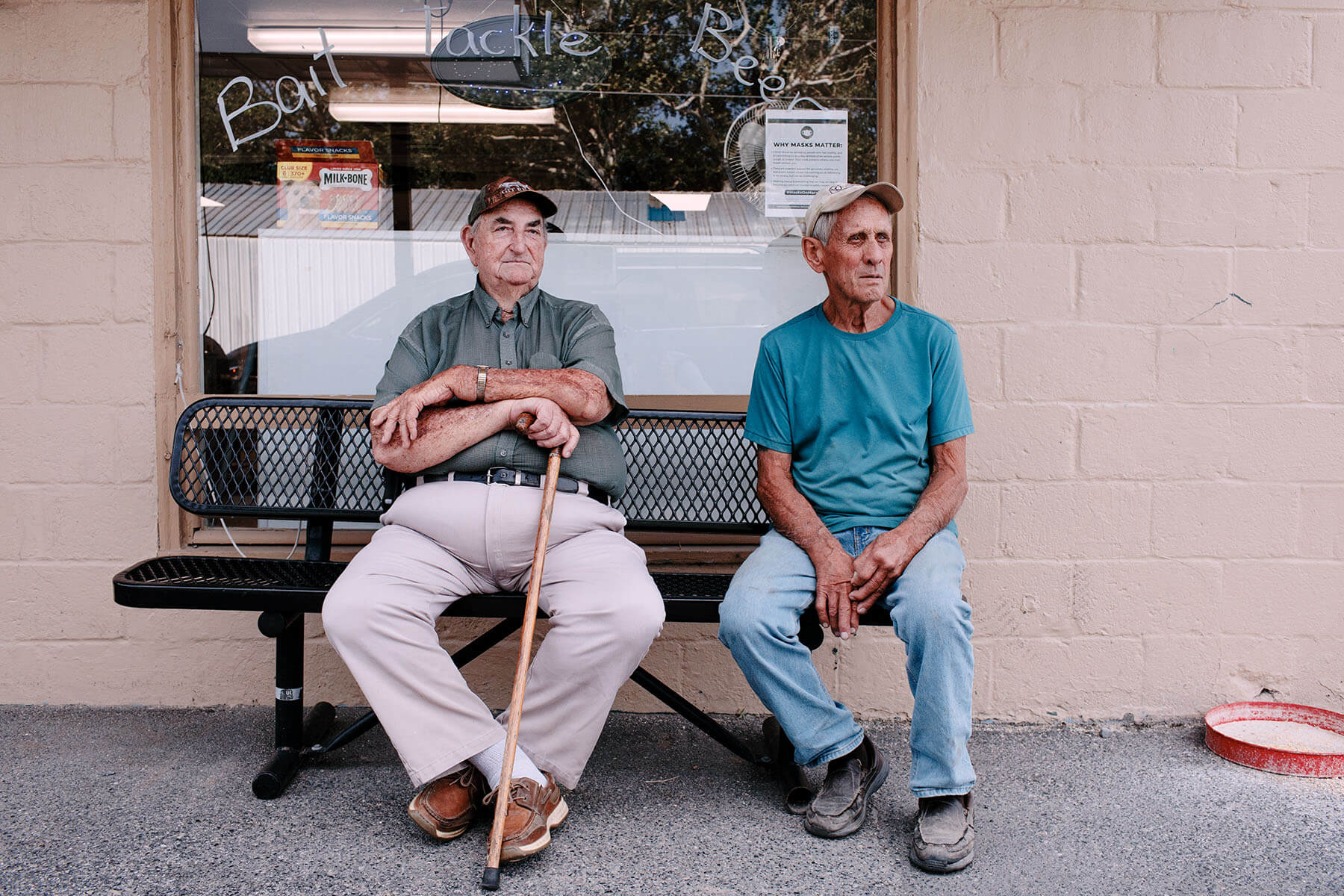 Two retired waterman sit outside local store.