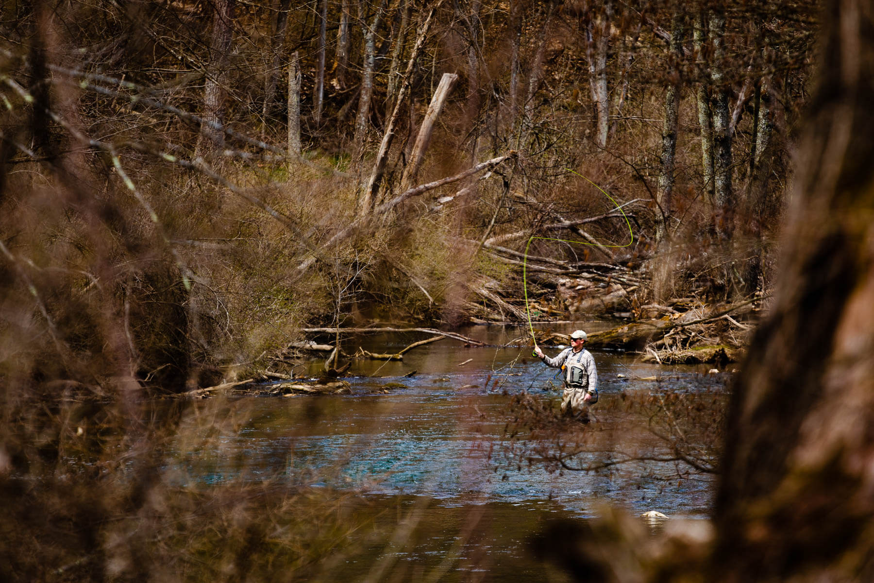 A fly fisher casts a line in Spring Creek in Centre County, Pa.