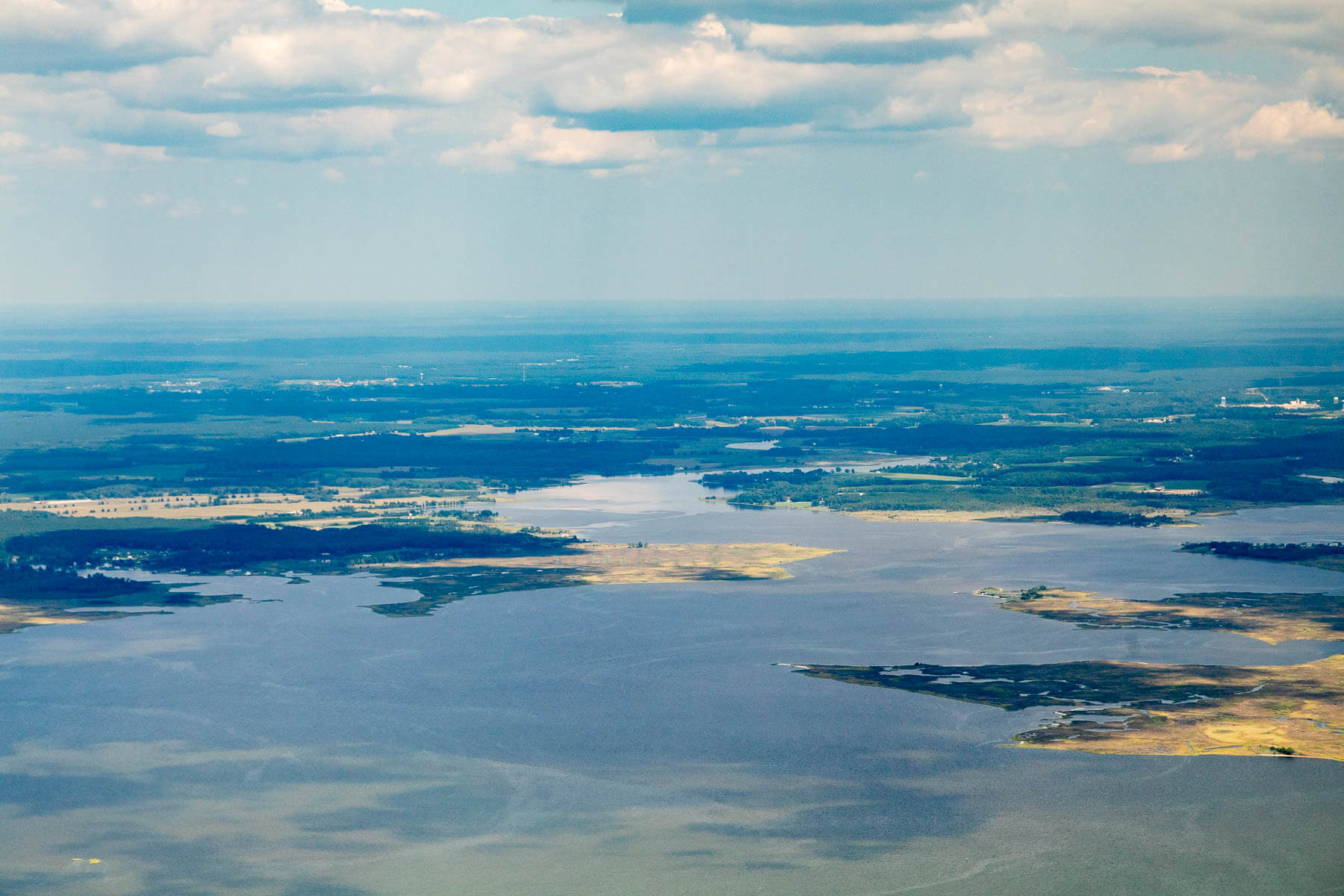 Aerial view of water, wetlands and land