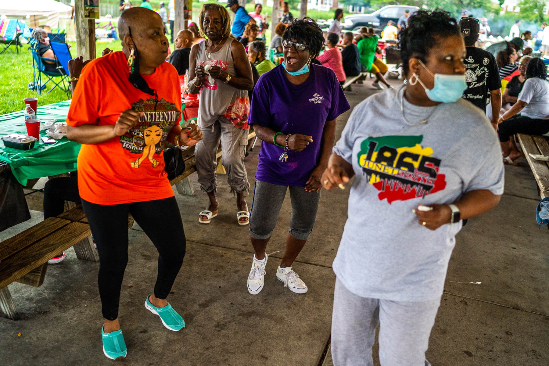 Women of Turner Station dance during a Juneteenth party.