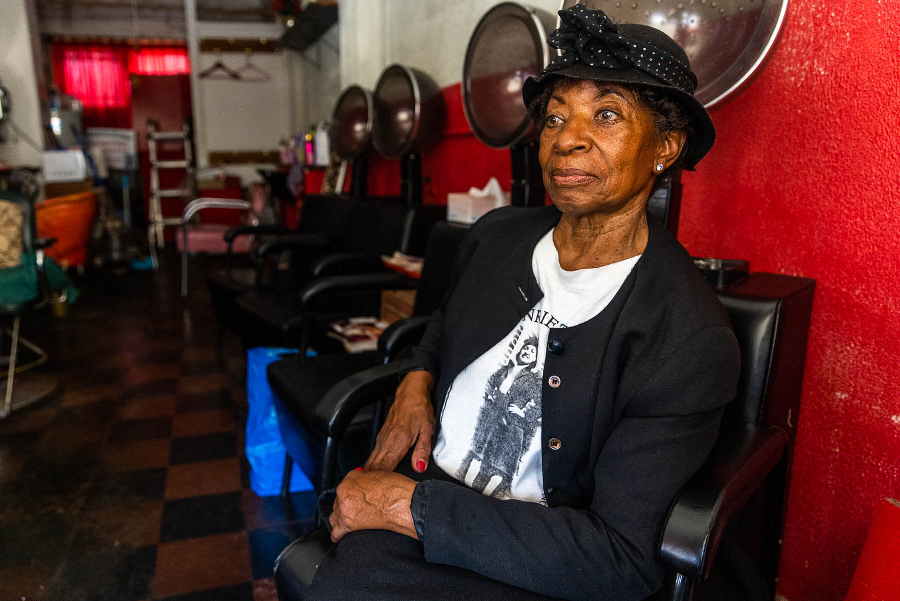 Turner Station resident Courtney Speed sits in a beauty salon.