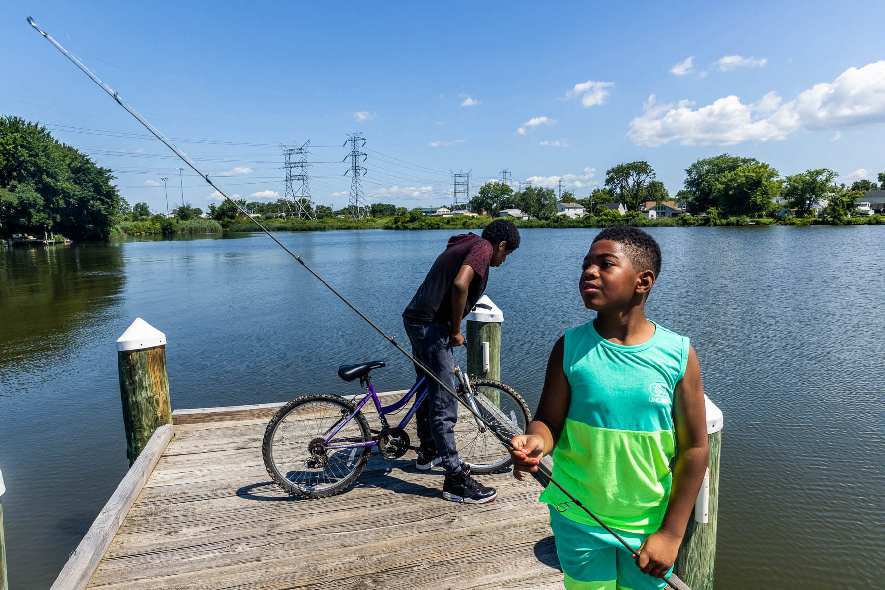 Young boys hang out on a dock by Bear Creek.