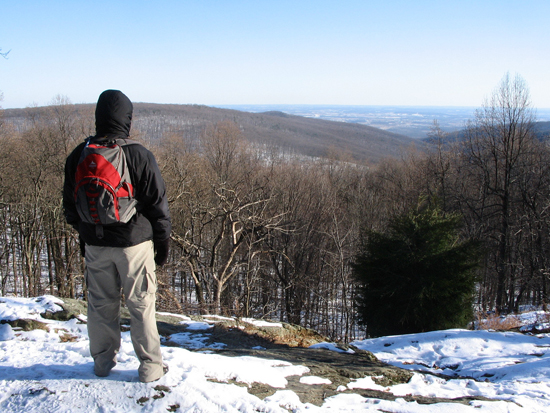 hiker at the top of Catoctin Mountain