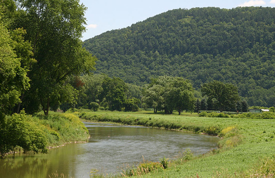 The Canisteo flows by mountainsides in the summertime.