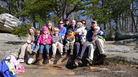 A group of young campers and their parents pose at Bull Run Mountains Conservancy.