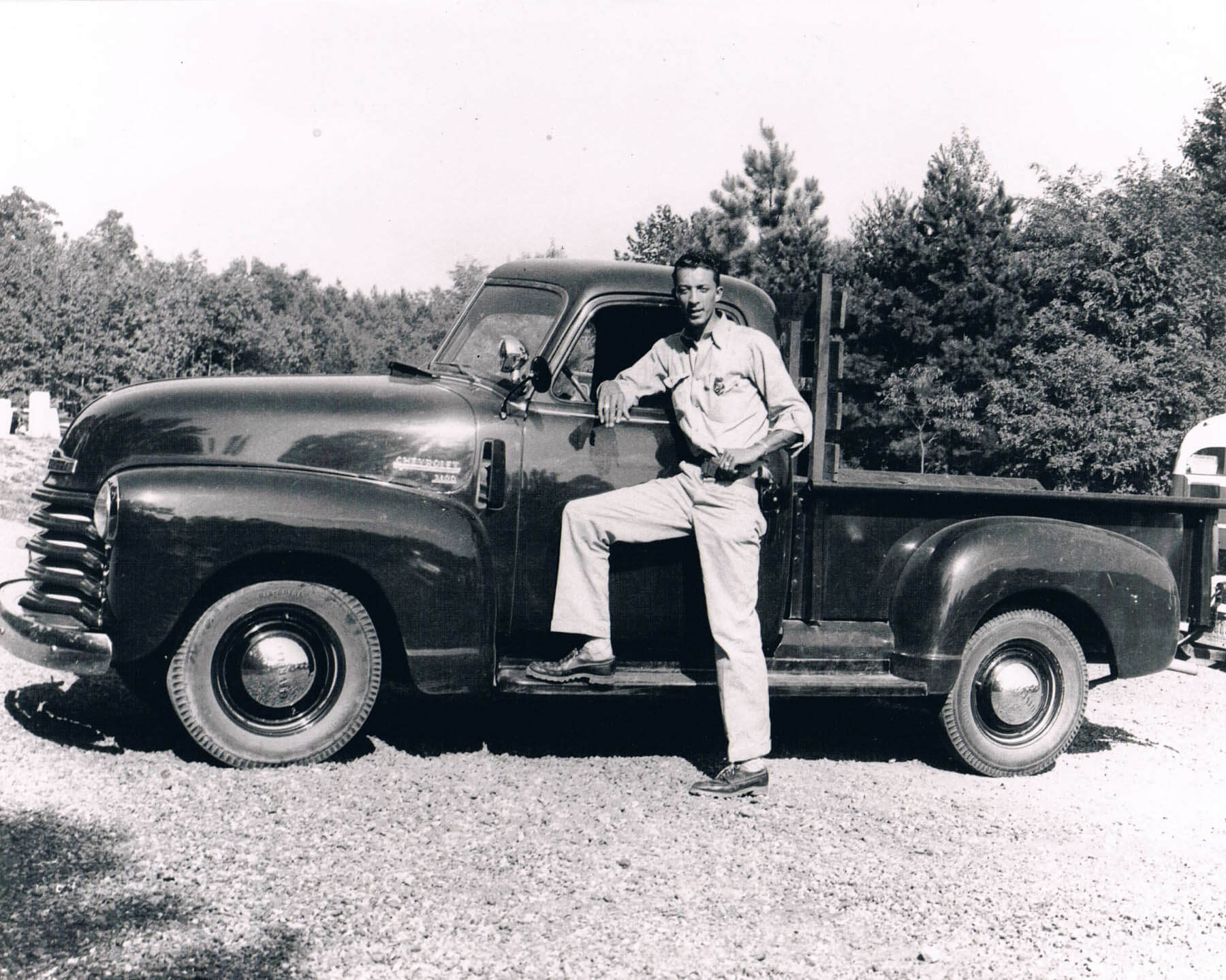 Superintendent Latham at Prince Edward State Park poses by a truck.