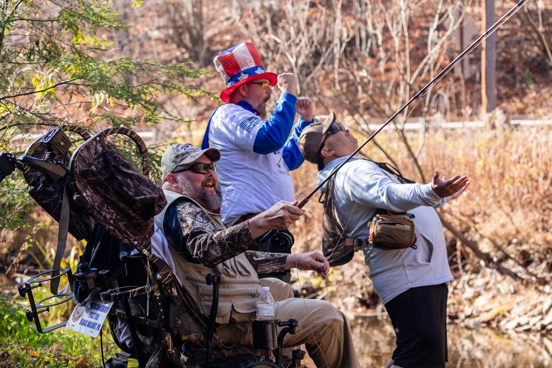 From left, Jason Wenton narrowly misses catching a fish with mentors Carl Stokes and Ardill Keeler.