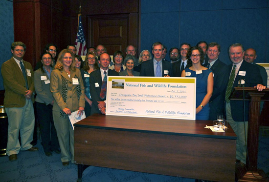 Grant recipients with big check